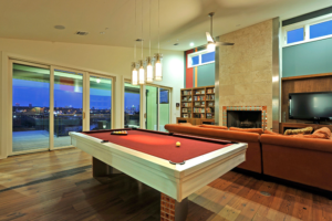 Study, den and library on second floor with balcony overlooking downtown Austin.